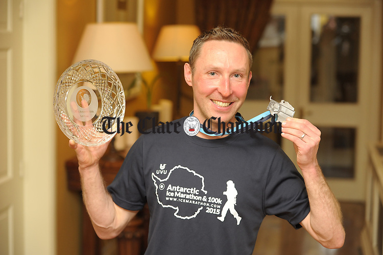 Ultra Runner Keith White with his trophy and medal during his homecoming at The Old Ground Hotel. Photograph by John