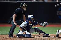 Hudson Valley Renegades catcher Anthony Seigler (20) sets a target as home plate umpire Adam Pierce looks on during the game against the Aberdeen IronBirds at Leidos Field at Ripken Stadium on July 23, 2021, in Aberdeen, MD. (Brian Westerholt/Four Seam Images)