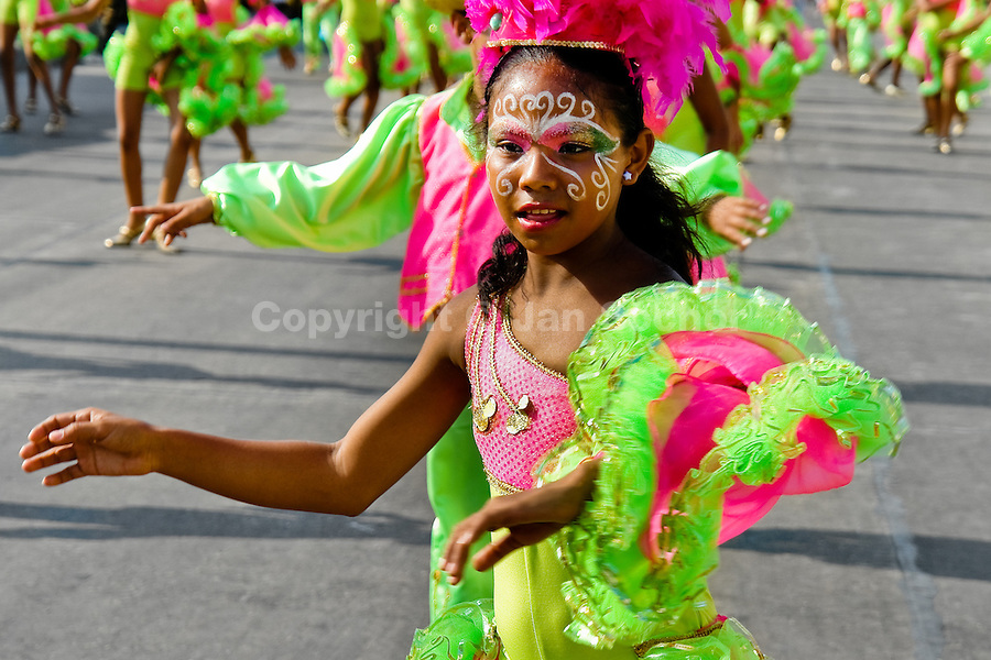 A Colombian girl, having her face colourfully painted, dances during the Carnival in Barranquilla, Colombia, 27 February 2006. The Carnival of Barranquilla is a unique festivity which takes place every year during February or March on the Caribbean coast of Colombia. A colourful mixture of the ancient African tribal dances and the Spanish music influence - cumbia, porro, mapale, puya, congo among others - hit for five days nearly all central streets of Barranquilla. Those traditions kept for centuries by Black African slaves have had the great impact on Colombian culture and Colombian society. In November 2003 the Carnival of Barranquilla was proclaimed as the Masterpiece of the Oral and Intangible Heritage of Humanity by UNESCO.