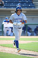 Santiago Chavez (17) of the Stockton Ports runs to first base during a game against the Rancho Cucamonga Quakes at LoanMart Field on May 28, 2017 in Rancho Cucamonga, California. Stockton defeated Rancho Cucamonga, 7-4. (Larry Goren/Four Seam Images)