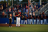 "Batavia Muckdogs starting pitcher Sean Guenther (39) stands with a ""Star of the Game"" during the national anthem before a game against the Auburn Doubledays on August 26, 2017 at Dwyer Stadium in Batavia, New York.  Batavia defeated Auburn 5-4.  (Mike Janes/Four Seam Images)"