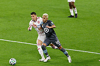ST PAUL, MN - SEPTEMBER 27: Emanuel Reynoso #10 of Minnesota United FC and Damir Kreilach #8 of Real Salt Lake battle for the ball during a game between Real Salt Lake and Minnesota United FC at Allianz Field on September 27, 2020 in St Paul, Minnesota.