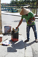 People burning papers before tet holliday in <br />  Hoi An, January, 2017