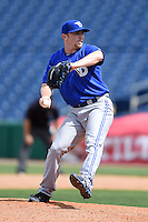 Dunedin Blue Jays pitcher Arik Sikula (50) delivers a pitch during a game against the Clearwater Threshers on April 6, 2014 at Bright House Field in Clearwater, Florida.  Dunedin defeated Clearwater 5-2.  (Mike Janes/Four Seam Images)