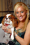 Erica Rose with her dog Shayna at the 23rd Annual Celebrity Paws Gala benefitting Citizens for Animal Protection's Shelter and Pet Adoption Center at the Hilton Americas Hotel Saturday Nov. 21,2009. (Dave Rossman/For the Chronicle)