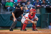 Louisville Bats catcher Chris Berset (10) and umpire James Rackley await a pitch during a game against the Buffalo Bisons on June 22, 2016 at Coca-Cola Field in Buffalo, New York.  Buffalo defeated Louisville 8-1.  (Mike Janes/Four Seam Images)