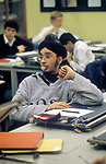 Asian 4th form male student blowing bubble gum in a CDT  class room lesson  Greenford High school Middlesex 1990s 1990