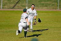 Slippery Rock outfielder Royce Copeland (4) and second baseman Jordan Faretta (11) go for a fly ball during a game against the Wayne State Warriors on March 15, 2013 at Chain of Lakes Park in Winter Haven, Florida.  (Mike Janes/Four Seam Images)