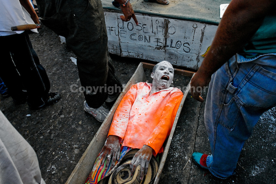 Joselito Carnaval (the main personage of the Carnival) lies in a coffin at the end of the Carnival in Barranquilla, Colombia, 28 February 2006. The Carnival of Barranquilla is a unique festivity which takes place every year during February or March on the Caribbean coast of Colombia. A colourful mixture of the ancient African tribal dances and the Spanish music influence - cumbia, porro, mapale, puya, congo among others - hit for five days nearly all central streets of Barranquilla. Those traditions kept for centuries by Black African slaves have had the great impact on Colombian culture and Colombian society. In November 2003 the Carnival of Barranquilla was proclaimed as the Masterpiece of the Oral and Intangible Heritage of Humanity by UNESCO.