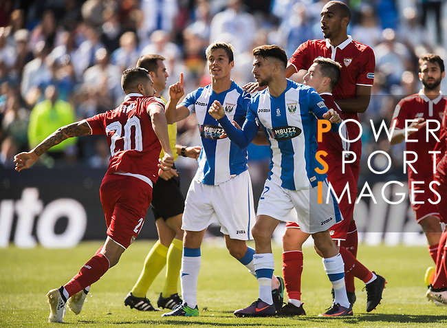 Vitolo (l) of Sevilla FC clashes with Martin Mantovani and Carl Medjani of Deportivo Leganes as Ruben Perez of Deportivo Leganes is injured during their La Liga match between Deportivo Leganes and Sevilla FC at the Butarque Municipal Stadium on 15 October 2016 in Madrid, Spain. Photo by Diego Gonzalez Souto / Power Sport Images