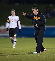 Maryland head coach Sasho Cirovski questions a referee's call after regulation time finished at the Maryland SoccerPlex in Germantown, MD. Maryland defeated Clemson, 1-0, in overtime.  With the win the Terrapins advanced to the finals of the ACC men's soccer tournament.