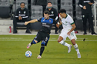 SAN JOSE, CA - SEPTEMBER 19: Vako #11 of the San Jose Earthquakes is defended by Julio Cascante #18 of the Portland Timbers during a game between Portland Timbers and San Jose Earthquakes at Earthquakes Stadium on September 19, 2020 in San Jose, California.