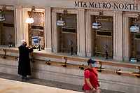 NEW YORK, NY - OCTOBER 20: A woman buys a MTA ticket at Gran Central Terminal on October 20, 2020 in New York, At least 7.4% MTA workers under NYC Transit have tested positive for the COVID-19 virus along the pandemic, or 3,921 out of about 53,000 workers, according to the MTA's statistics. (Photo by Eduardo MunozAlvarez/VIEWpress)