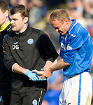 St Johnstone v Partick Thistle...28.09.13      SPFL<br /> Steven Anderson leaves the pitch with a dislocated thumb<br /> Picture by Graeme Hart.<br /> Copyright Perthshire Picture Agency<br /> Tel: 01738 623350  Mobile: 07990 594431
