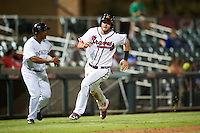 Salt River Rafters Dustin Peterson (16), of the Atlanta Braves organization, runs down the third base line to score a run in front of manager Tony Diaz (7) waving him home during a game against the Surprise Saguaros on October 21, 2016 at Salt River Fields at Talking Stick in Scottsdale, Arizona.  Salt River defeated Surprise 3-2.  (Mike Janes/Four Seam Images)
