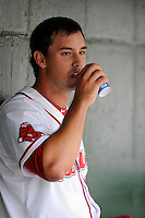 Pitcher Reed Reilly (33) of the Greenville Drive gets a drink in the dugout during a game against the Hagerstorn Suns on May 12, 2015, at Fluor Field at the West End in Greenville, South Carolina. Greenville won, 4-0. (Tom Priddy/Four Seam Images)