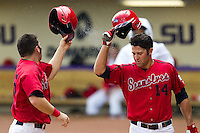 Stony Brook Seawolves outfielder Sal Intagliata #14 greets teammate Kevin Courtney #25 after Courtney homered during the NCAA Super Regional baseball game against LSU on June 9, 2012 at Alex Box Stadium in Baton Rouge, Louisiana. Stony Brook defeated LSU 3-1. (Andrew Woolley/Four Seam Images)