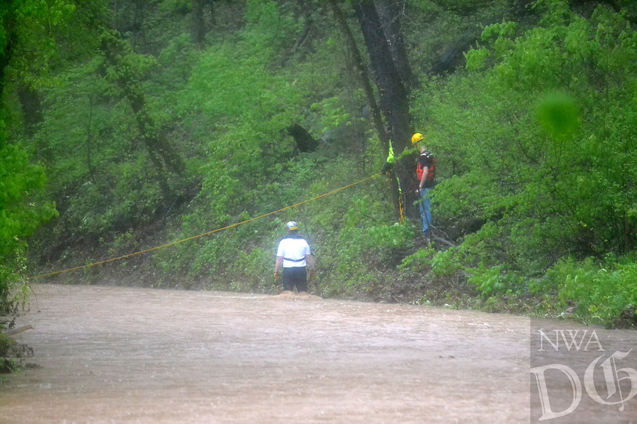 Bella Vista and Rogers Fire Department water rescue personnel assisted Little FLock in rescuing two men from the flood waters on Rustic Drive in Little Flock. <br /> (Pea Ridge Times/Annette Beard)