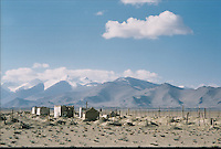 A cemetery near the Karakul lake at 3914 meters high..The M41 Highway from the Ismaili capital of Khorog to the south capital of Kyrgyzstan - Osh, via the head district of Badakhshan - Murgab and the Akbajtal Pass at 4655 meters.