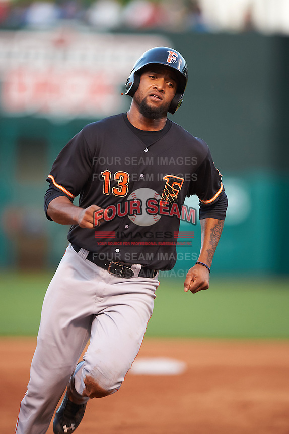 Fresno Grizzles outfielder Domingo Santana (13) running the bases during a game against the Oklahoma City Dodgers on June 1, 2015 at Chickasaw Bricktown Ballpark in Oklahoma City, Oklahoma.  Fresno defeated Oklahoma City 14-1.  (Mike Janes/Four Seam Images)