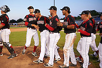 Batavia Muckdogs relief pitcher Steven Farnworth (second from left) is congratulated by teammates including Jordan Holloway, Ryan Cranmer, Brad Haynal and Kyle Barrett (L-R) after a game against the Mahoning Valley Scrappers on June 24, 2015 at Dwyer Stadium in Batavia, New York. Batavia defeated Mahoning Valley 1-0 as Gabriel Castellanos, Brett Lilek and Farnworth combined on the organizations first perfect game in team history. (Mike Janes/Four Seam Images)