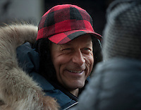 Four-time Iditarod champion Martin Buser of Big Lake chats with well-wishers at the ceremonial start of the 2014 Iditarod Dogsled Race in downtown Anchorage, Alaska. Sixty-nine mushers paraded their teams through Anchorage today and will depart from the official start in Willow tomorrow to begin the 975-mile race to Nome.