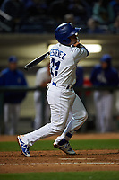 Rancho Cucamonga Quakes second baseman Omar Estevez (21) follows through on his swing during a California League game against the Lake Elsinore Storm at LoanMart Field on May 19, 2018 in Rancho Cucamonga, California. Lake Elsinore defeated Rancho Cucamonga 10-7. (Zachary Lucy/Four Seam Images)