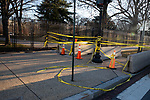 Police tape and fencing block off access to the U.S. Capitol ahead of President-Elect Joe Biden's Inauguration on January 19, 2021 in Washington, D.C..  Photograph by Michael Nagle