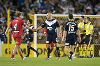 MELBOURNE, AUSTRALIA - OCTOBER 30: Kevin Muscat of the Victory shakes hands with Iain Fyfe of United at the end of the round 12 A-League match between the Melbourne Victory and Adelaide United at Etihad Stadium on October 30, 2010 in Melbourne, Australia.  (Photo by Sydney Low / Asterisk Images)