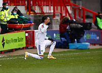 10th January 2021; Broadfield Stadium, Crawley, Sussex, England; English FA Cup Football, Crawley Town versus Leeds United; Hélder Costa of Leeds united taking a knee