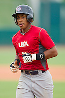 Francisco Lindor #12 jogs back to the dugout after making an out during the USA Baseball 18U National Team Trials at the USA Baseball National Training Center on June 30, 2010, in Cary, North Carolina.  Photo by Brian Westerholt / Four Seam Images
