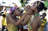 Members of a Mas band adjust costumes before going2 out on the road during Notting Hill Carnival