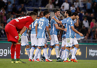 Calcio, Serie A: Lazio vs Frosinone. Roma, stadio Olimpico, 4 ottobre 2015.<br /> Lazio's Filip Djordjevic, third from right, celebrates with teammates after scoring during the Italian Serie A football match between Lazio and Frosinone at Rome's Olympic stadium, 4 October 2015.<br /> UPDATE IMAGES PRESS/Isabella Bonotto