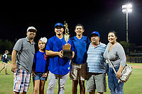 Kevin Zamudio (4) of the AZL Giants and his family pose with the Chuck Jared Championship Cup after winning Game Three of the Arizona League Championship Series against the AZL Giants on September 7, 2017 at Scottsdale Stadium in Scottsdale, Arizona. AZL Cubs defeated the AZL Giants 13-3 to win the series two games to one. (Zachary Lucy/Four Seam Images)