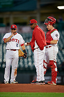 Louisville Bats manager Delino DeShields (90) makes a pitching change as catcher Chad Wallach and Hernan Iribarren (2) look on during a game against the Columbus Clippers on May 1, 2017 at Louisville Slugger Field in Louisville, Kentucky.  Columbus defeated Louisville 6-1  (Mike Janes/Four Seam Images)