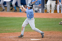 Mike Cavasinni #11 of the North Carolina Tar Heels follows through on his swing versus the Clemson Tigers at Durham Bulls Athletic Park May 23, 2009 in Durham, North Carolina. The Tigers defeated the Tar Heals 4-3 in 11 innings.  (Photo by Brian Westerholt / Four Seam Images)