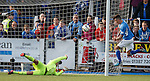 Derek Lyle heads in past Rangers keeper Cammy Bell to score for Queens