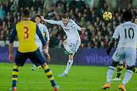 Sunday 9th November 2014<br /> Pictured: Gylfi Sigurosson of Swansea City takes a missed shot at goal <br /> Re: Barclays Premier League Swansea City v Arsenal at the Liberty Stadium, Swansea, Wales,UK