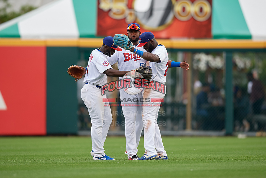 Buffalo Bisons outfielders Roemon Fields (4), Socrates Brito (51), and Anthony Alford (26) celebrate closing out an International League game against the Norfolk Tides on June 21, 2019 at Sahlen Field in Buffalo, New York.  Buffalo defeated Norfolk 2-1, the first game of a doubleheader.  (Mike Janes/Four Seam Images)
