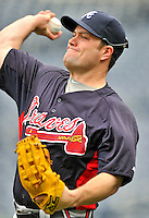 24 September 2011: Atlanta Braves outfielder Matt Diaz warms up prior to a game against the Washington Nationals at Nationals Park in Washington, DC. The Nationals defeated the Braves 4-1 to even up their 3-game series. Mandatory Credit: Ed Wolfstein Photo