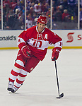 31 December 2013: Former Detroit Red Wings forward Brendan Shanahan (14) skates with the puck for his shootout attempt, during the Toronto Maple Leafs v Detroit Red Wings Alumni Showdown hockey game, at Comerica Park, in Detroit, MI.