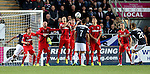 Alex Cooper lofts the ball over the Rangers wall