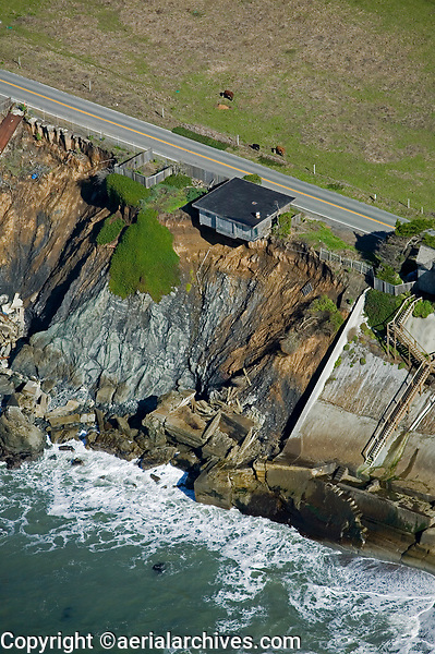 aerial photograph of a house ready to fall into the Pacific Ocean because of erosion on the Pacific Coast along Highway One in Sonoma County, California