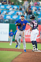 Midland RockHounds infielder Luis Barrera (22) (left) reacts after an umpire's safe call on Northwest Arkansas Naturals infielder Travis Jones (27) on May 4, 2019, at Arvest Ballpark in Springdale, Arkansas. (Jason Ivester/Four Seam Images)