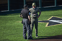 Vanderbilt Commodores head coach Tim Corbin has a discussion with home plate umpire Fred Cannon during the game against the South Carolina Gamecocks at Hawkins Field on March 21, 2021 in Nashville, Tennessee. (Brian Westerholt/Four Seam Images)