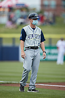 Columbia Fireflies manager Brooks Conrad (26) coaches third base during the game against the Kannapolis Cannon Ballers at Atrium Health Ballpark on May 18, 2021 in Kannapolis, North Carolina. (Brian Westerholt/Four Seam Images)