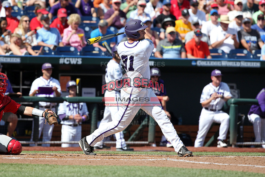 Jerrick Suiter #31 of the TCU Horned Frogs bats during Game 3 of the 2014 Men's College World Series between the Texas Tech Red Raiders and TCU Horned Frogs at TD Ameritrade Park on June 15, 2014 in Omaha, Nebraska. (Brace Hemmelgarn/Four Seam Images)