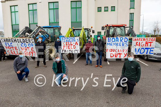 A group of Kerry farmers protest at the Kerry Co-Op offices in Fells Point  on Thursday. Kneeling: Cathal Crowley (Kilorglin), Donnacha Crowley (Beaufort) and Sean Enright (Tarbert).
