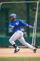GCL Blue Jays third baseman Sterling Guzman (5) at bat during a game against the GCL Braves on August 5, 2016 at ESPN Wide World of Sports in Orlando, Florida.  GCL Braves defeated the GCL Blue Jays 9-0.  (Mike Janes/Four Seam Images)