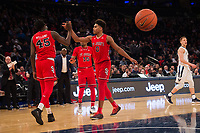 NEW YORK, NY - Thursday March 9, 2017: Darien Williams (#45) of St. John's and Malik Ellison (#0) of St. John's high-five after a big play against Villanova as the two schools square off in the Quarterfinals of the Big East Tournament at Madison Square Garden.